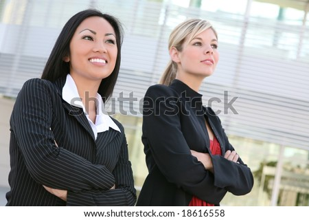 A diverse business woman team outside office building - stock photo