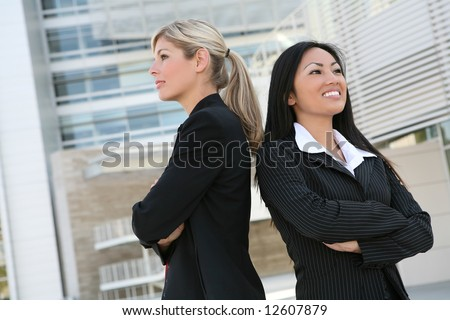 A diverse business woman team standing back to back - stock photo