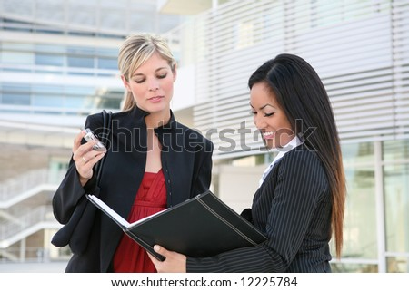 A diverse business woman team working on a project - stock photo