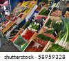A diverse cornucopia of fresh food is offered at the Belle-le-en-Mer outdoor market.   Belle-le-en-Mer is a small French island off the coast of Brittany. - stock photo