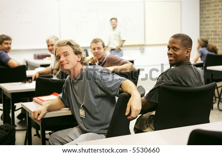 A diverse group of adult education students in class. - stock photo