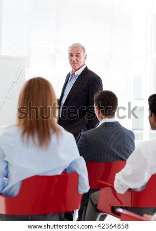 A diverse group of business people at a seminar in the office - stock photo