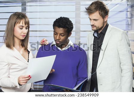 A diverse group of business people in the office - stock photo