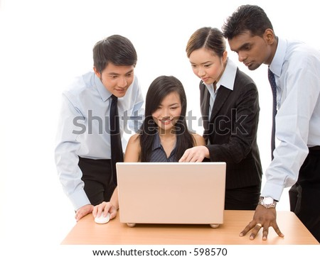 A diverse group of business people work on a laptop