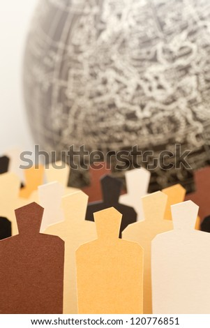 A diverse group with the Earth on the background. Focus on the central yellow figure - stock photo