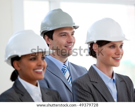 A diverse team of architects standing during at conference in a company - stock photo