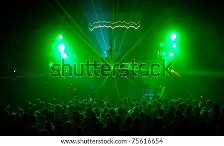 A dj performing at a disco rave party - stock photo