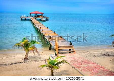 A Dock on the Coast of Belize - stock photo