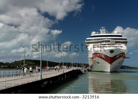 A docked cruise ship in a caribbean port