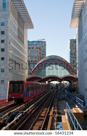 A Docklands Light Rail train passing through Canary Wharf in London - stock photo