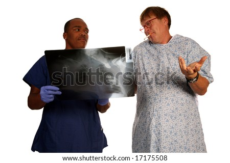 A doctor and patient discuss a mans continuing to smoke cigarettes even with evidence of lung cancer Anti-Smoking Concept series - stock photo