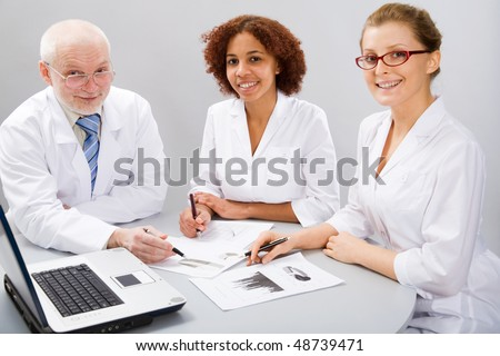 A doctor and team - stock photo