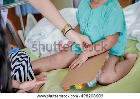 a doctor at home visits. examines sick child.