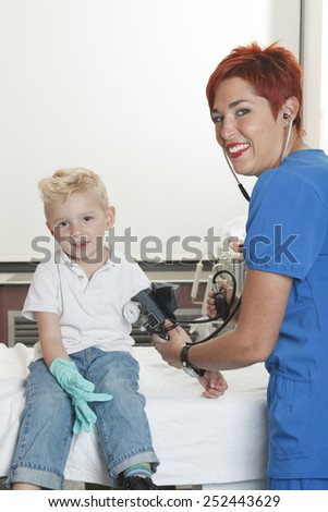 A Doctor Examining cute little boy - stock photo