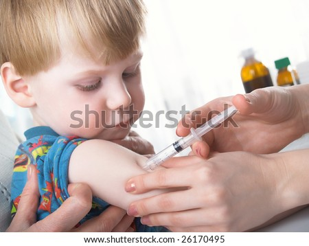 A doctor giving a child an injection,
