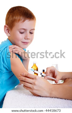 A doctor giving a child an injection - stock photo