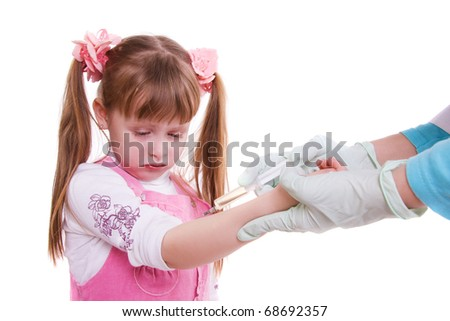 A doctor giving little girl an injection - stock photo
