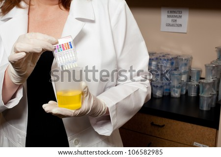 A doctor holding a urine sample - stock photo