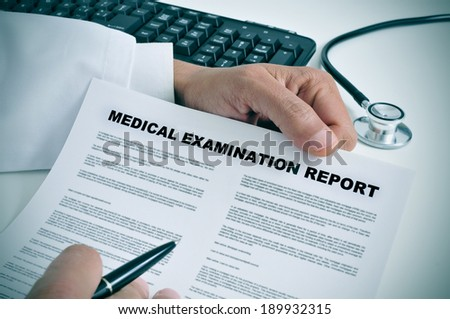 a doctor in his office showing a medical examination report - stock photo