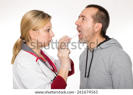 A doctor is looking into a patient's throat
