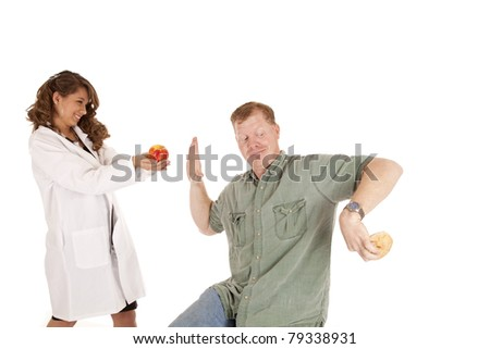 a doctor is trying to give her patient an apple, but the patient is hiding a doughnut behind his back and does not want the apple.