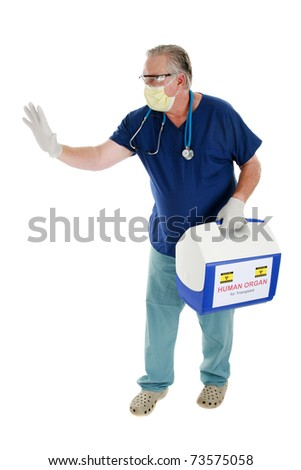 a doctor, or cardiac surgeon, or nurse, or emt, holds and delivers an ice chest with a Human Heart for transplant, being preserved on ice while in transit. isolated on white with room for your text - stock photo