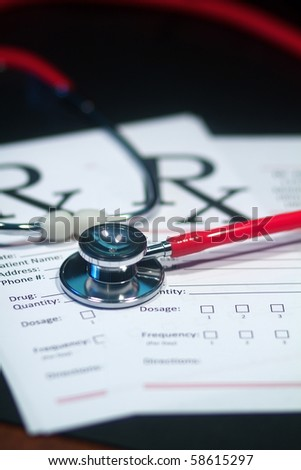 A doctor's medical stethoscope in moody dark lighting - stock photo