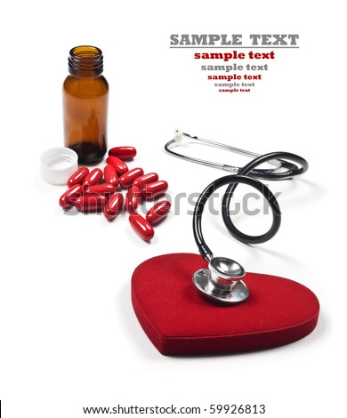 a Doctor's stethoscope listening to a healthy red heart and pill bottle with pills - stock photo