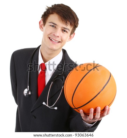 A doctor smiling holding a basketball, isolated on white - stock photo