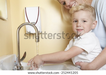 A Doctor with a cute little boy wash hand - stock photo