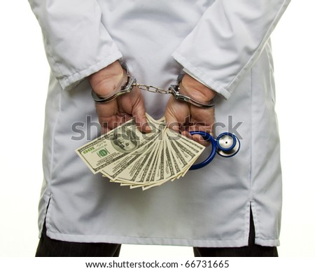 A doctor with dollar bank notes and handcuffs