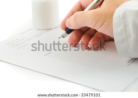 a doctors hand with an ink pen - stock photo