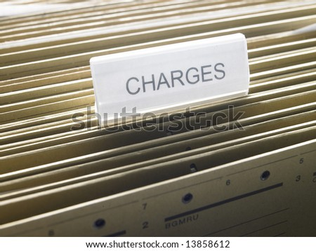 "a document cabinet with a folder called ""Charges"""