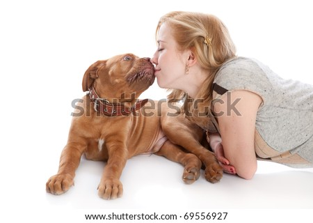 a dog is licking her beautiful mistress. isolated on a white background - stock photo