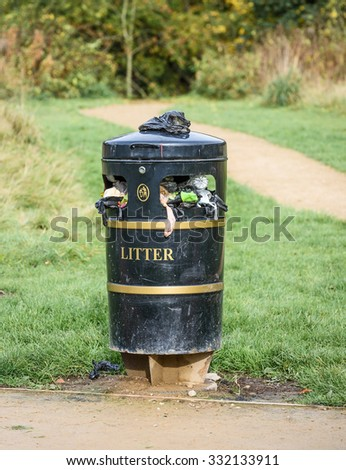A 'Dog Waste Station' that is overloaded due to not being emptied out by the local council - stock photo