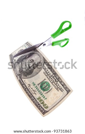a dollar bill and a pair of scissors. photo icon on taxes