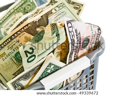 A dollars in a plastic basket. Isolated.  Welcome! More similar images available.