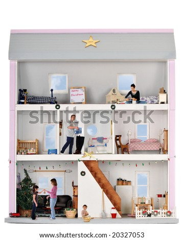A dollhouse family of five preparing for Christmas. - stock photo