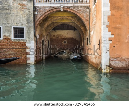 A door and boat dock in a house on a Venice canal. - stock photo