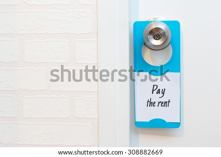 A door hanger write a message pay the rent on a door with copy space & Pay Rent Stock Images Royalty-Free Images u0026 Vectors | Shutterstock pezcame.com