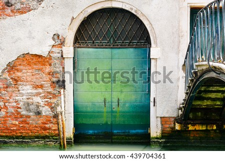 A door of a building along a canal in Venice, Italy - stock photo