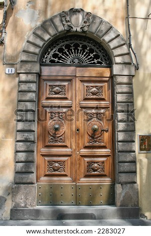 A door of an elegant palace in Lucca, Tuscany,Italy - stock photo
