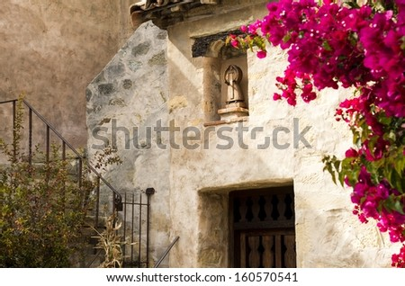 a doorway and stairs at the Carmel Mission in Carmel, Ca. - stock photo