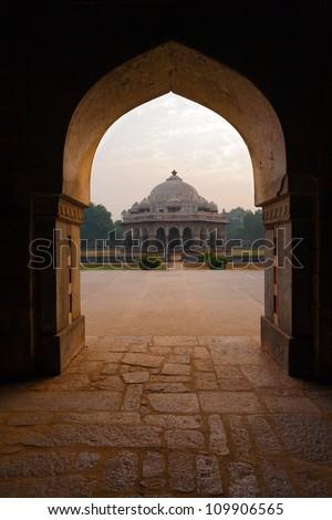 A doorway frames the Ali Isa Khan Niazi Tomb in the Humayun Tomb complex in Delhi, India - stock photo