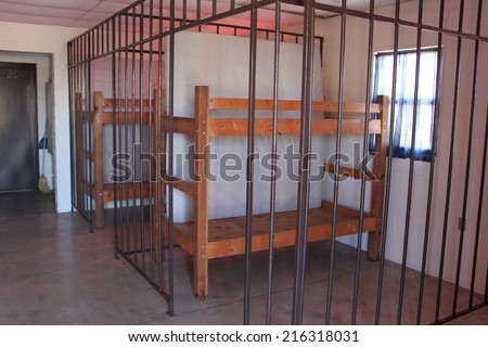 A double bunk in a pretend jail cell. - stock photo