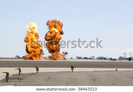 a double explosion at a military demonstration during an airshow - stock photo