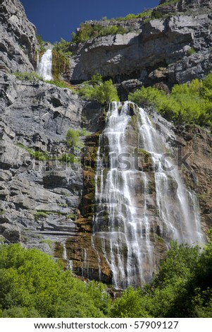 """A double waterfall called """"Bridal Veil Falls"""" cascades down the cliffs of the mountains in Utah, in the western United States. - stock photo"""