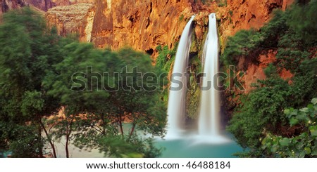 A double waterfall on the Havasupai Indian Reservation which is located in the Arizona's Grand Canyon. - stock photo
