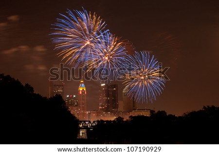 A downtown fireworks display in Columbus Ohio. The fireworks show is called Red, White, & Boom and attracts nearly 500,000 people. - stock photo