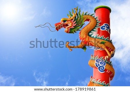a dragon sculpture with blue sky background - stock photo